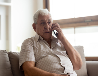 Older man sitting on the phone
